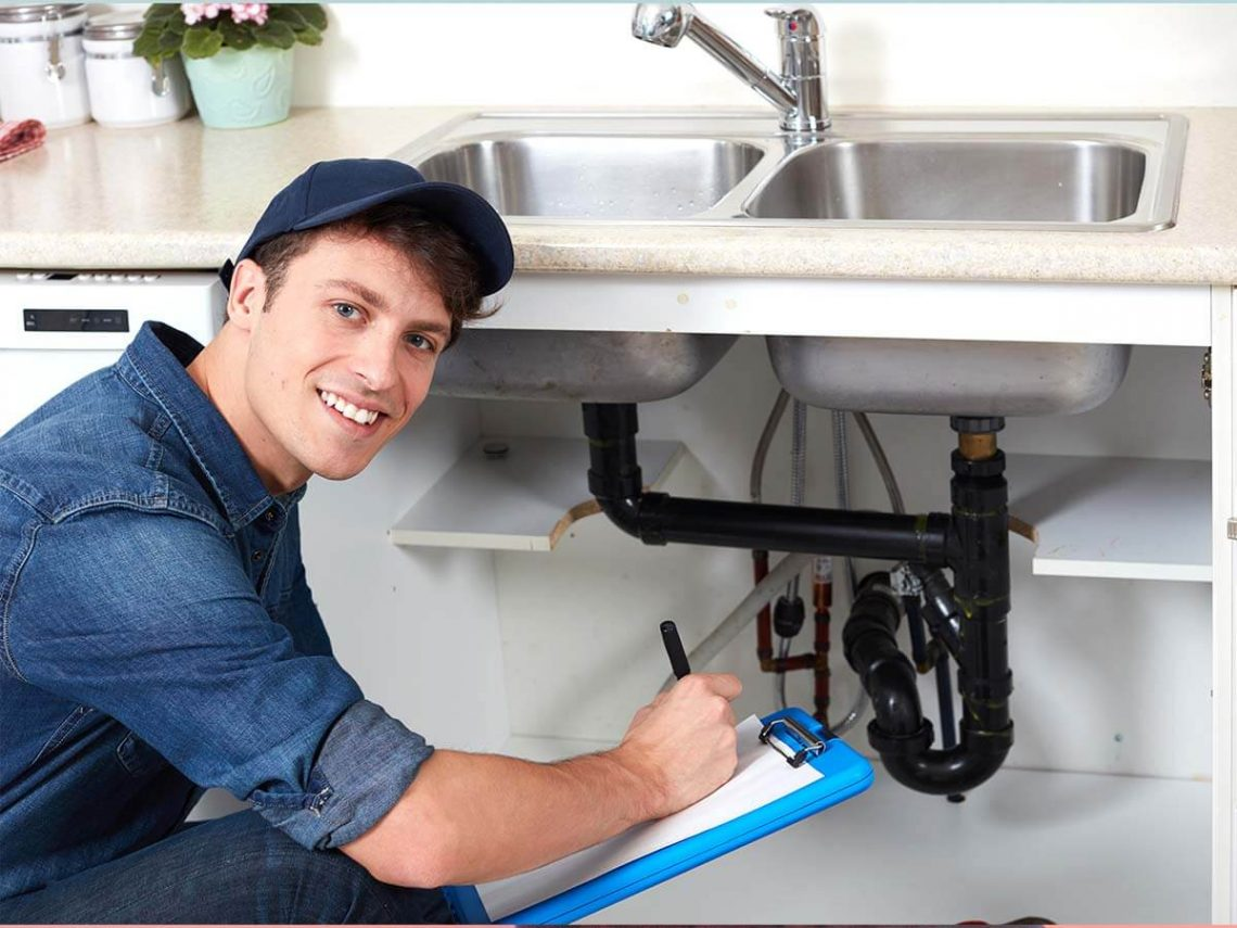 An image of a plumber smiling.