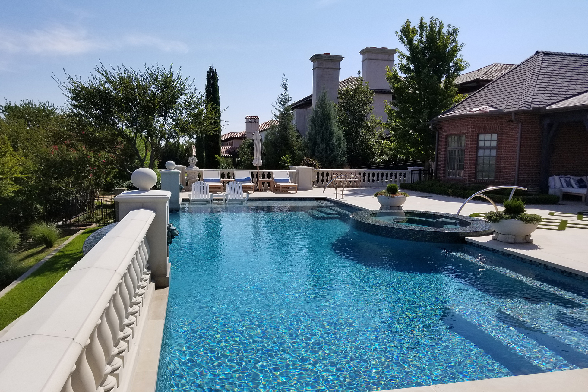 Boutique pool, including spa and lounge