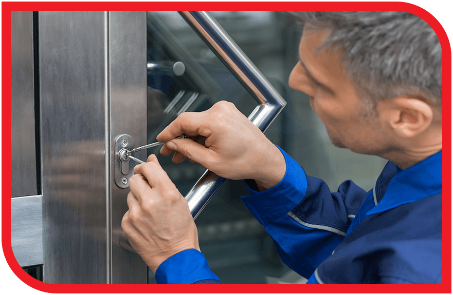 Locksmith working on the lock of a commercial door