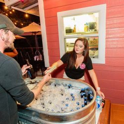 Server handing out beers from a trough at our bar and grill - The 4 Way Bar and Grill