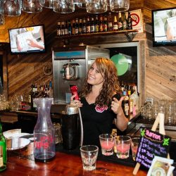 Happy server behind the bar at our local restaurant - The 4 Way Bar and Grill