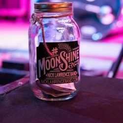A jar with a moonshine label at our bar and grill - The 4 Way Bar and Grill