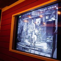 Outside TV showing the band playing at our bar and grille - The 4 Way Bar and Grill