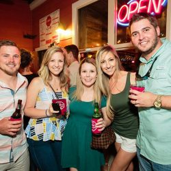 Photo of four friends holding drinks at The 4 Way Bar & Grill in Lakehills.