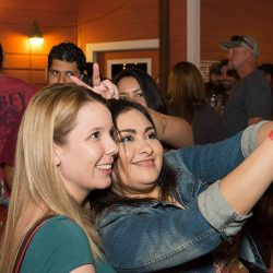 Friends taking a selfy at our bar and grill - The 4 Way Bar and Grill