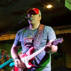 Man singing with electric guitar and our restaurant with live music - The 4 Way Bar and Grill