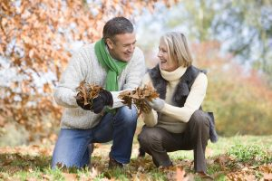 bigstockphoto_Couple_Playing_In_Leaves_3915079