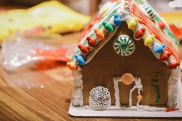 Image of a gingerbread house assembled and decorated with frosting and candy.