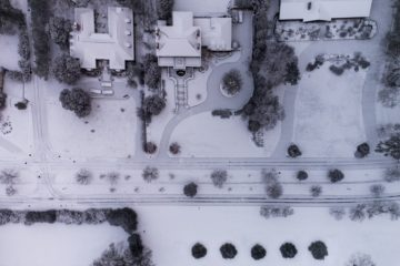 Aerial view of a neighborhood in Knoxville, Tennessee, covered in snow.