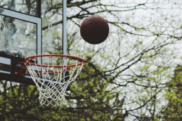 Photo of a basketball about to swish through the hoop.