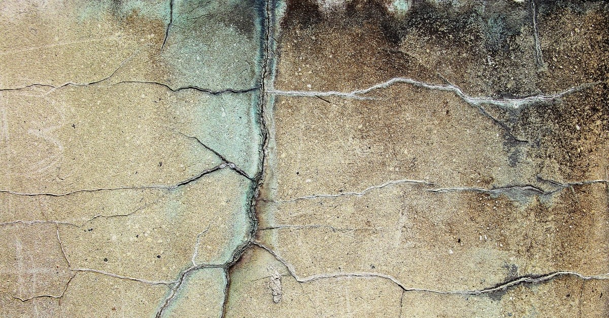 Image of cracked brown concrete.