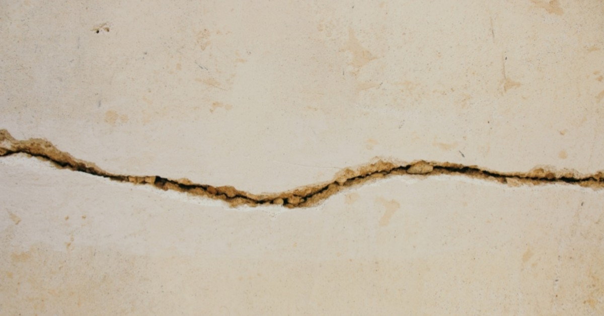 Image of a wall with a large horizontal crack.