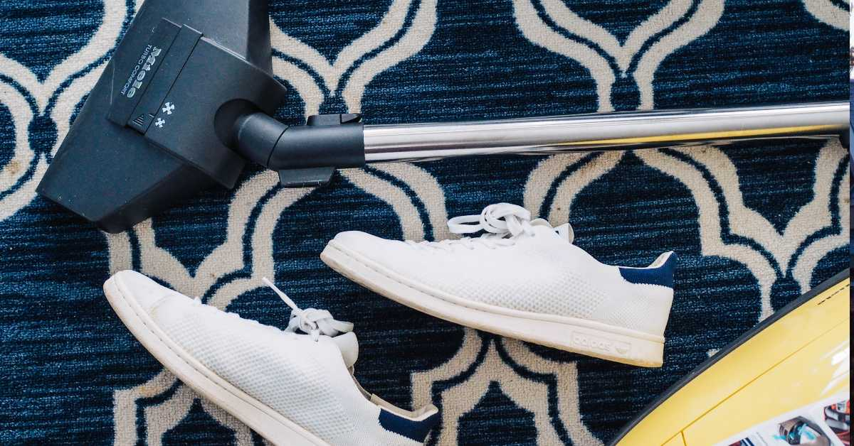 Photo of white sneakers next to vacuumby The Creative Exchange on Unsplash