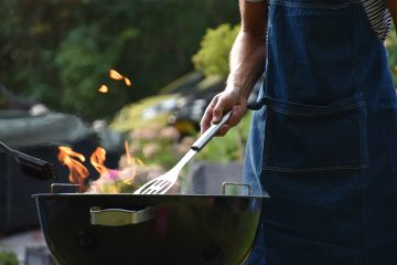 Photo of a man grilling outdoors by Vincent Keiman on Unsplash