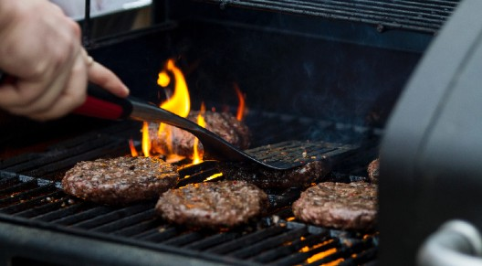 person grilling