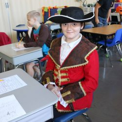 A child with autism shows his love of Halloween by dressing up at his school for autism.