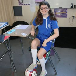 At a school for autism, this student dresses up as a soccer player.