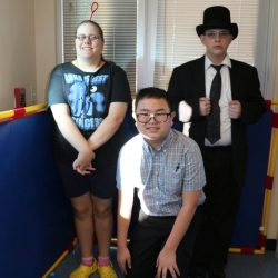 Three children with autism at the Autism Academy, located in Arizona, show off their costumes for Halloween.