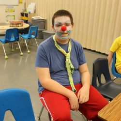 A child with autism embraces his funny side at the Autism Academy.