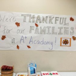 A sign stating how thankful children with autism are for their families and to be at the Autism Academy.