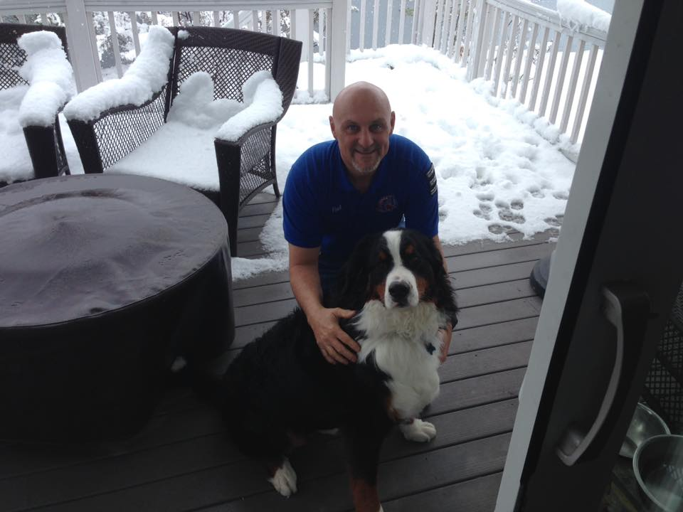 Paul and dog Dexter pose outside before a carpet cleaning job