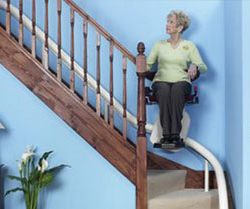 Curved Stairlift With Woman on Stairs
