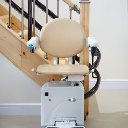 Beige Seat Stairlift at Base of Stairs