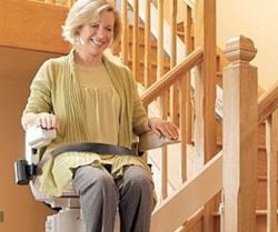 Curved Stairlift With Woman on Chair
