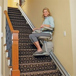 Senior Woman Using Elan Stairlift