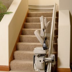 Folded Seat of Stairlift at Base of Stairs