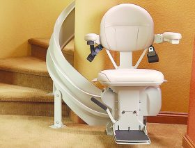 Curved Rail Stairlift Seat at Base of Stairs