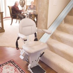 Stairlift Seat with Elderly Couple in Background