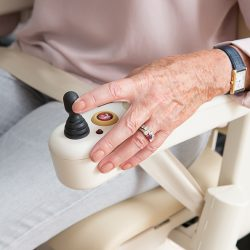 Close-Up of Woman Using Stairlift Controls