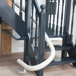 Curved Rail Stairlift Track at Base of Stairs
