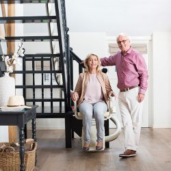 Curved Rail Stairlift With Senior Couple