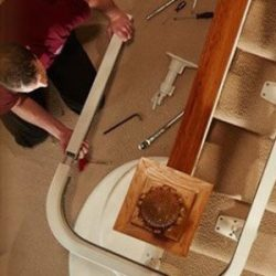 Man Installing Stairlift in Home