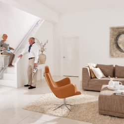 Couple in Modern Home With Straight Rail Stairlift