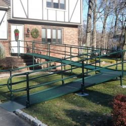 Green Wheelchair Ramp Leading to Front Door