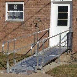 Metal Wheelchair Ramp Leading to White Door