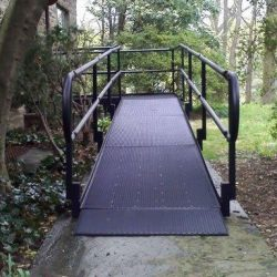 Black Wheelchair Ramp Next to Trees and Yard