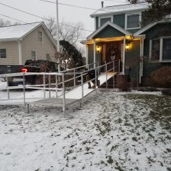 Man Installing Wheelchair Ramp in Winter