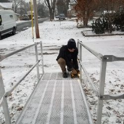 Man Installing Aluminum Wheelchair Ramp