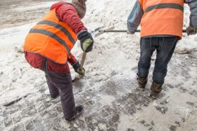 Men Shoveling a Sidewalk