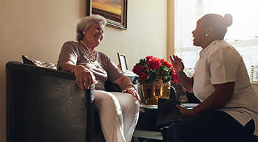 Nurse Consulting With a Senior Woman