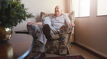 Senior Man in Chair Laughing