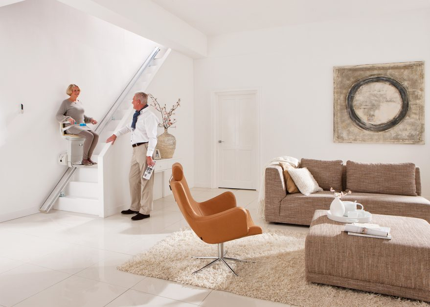 Senior Couple in Modern Home With Stairlift