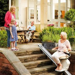 Woman Using Outdoor Stairlift