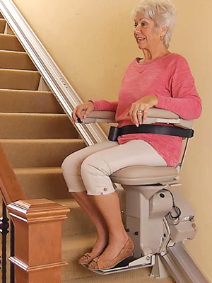 Woman on Wall-Mounted Stairlift