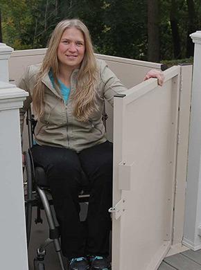 Woman Opening Residential Platform Lift Door