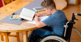 Child Doing Homework in a Wheelchair